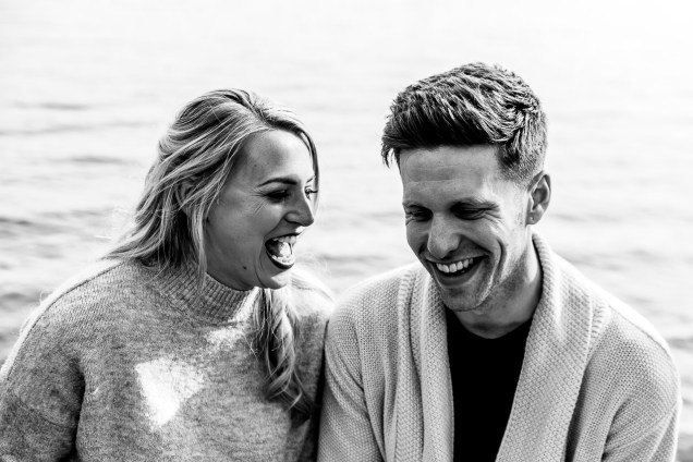 Laughing at each others jokes during their engagement photoshoot