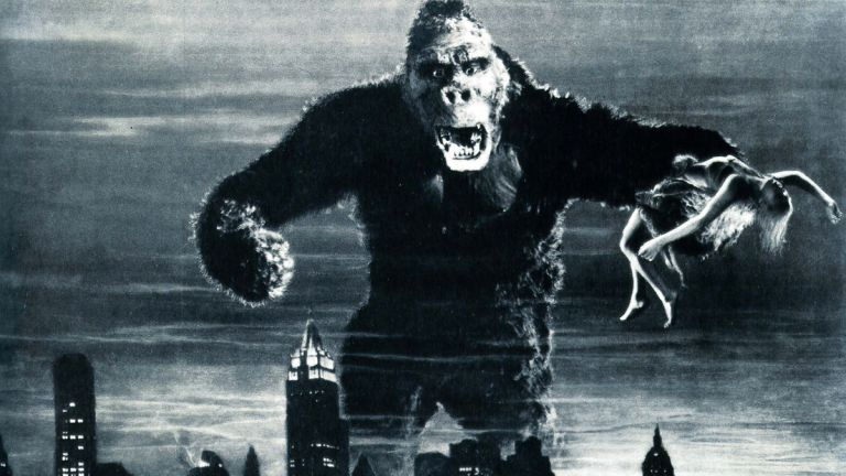 This is a marketing image from KING KONG (1933) showing Kong towering about the skyline of New York.