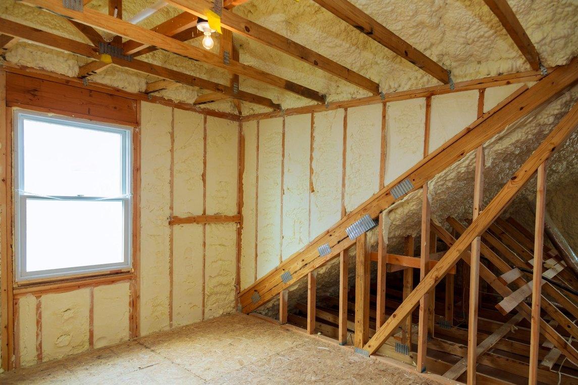 spray foam insulation within interior of home