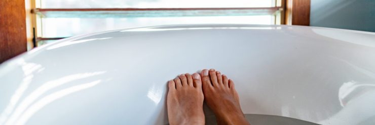 Taking an epsom salt bath helps reduce a fever, one step to treat a virus naturally