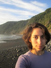 gracie on a beach wearing purple