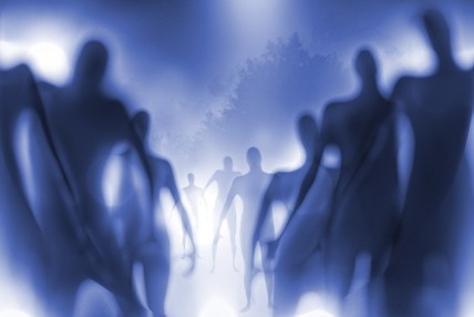 Blurry and grainy image of strange human-like beings.