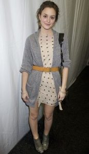 Leighton Meester poses backstage at fashion week after attending the Phillip Lim fashion show.