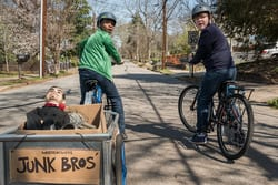 """Sonny (Jeremy Ray Taylor, right) and Sam (Caleel Harris, left) finish loading their """"Junk Bros"""" wagon with goods from the abandoned house in Columbia Pictures' GOOSEBUMPS 2: HAUNTED HALLOWEEN."""