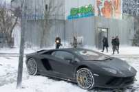 Jan Holster (Claes Bang) and Henchmen at the old Radar Tower with the Lamborghini Aventador in Columbia Pictures' THE GIRL IN THE SPIDERS' WEB.