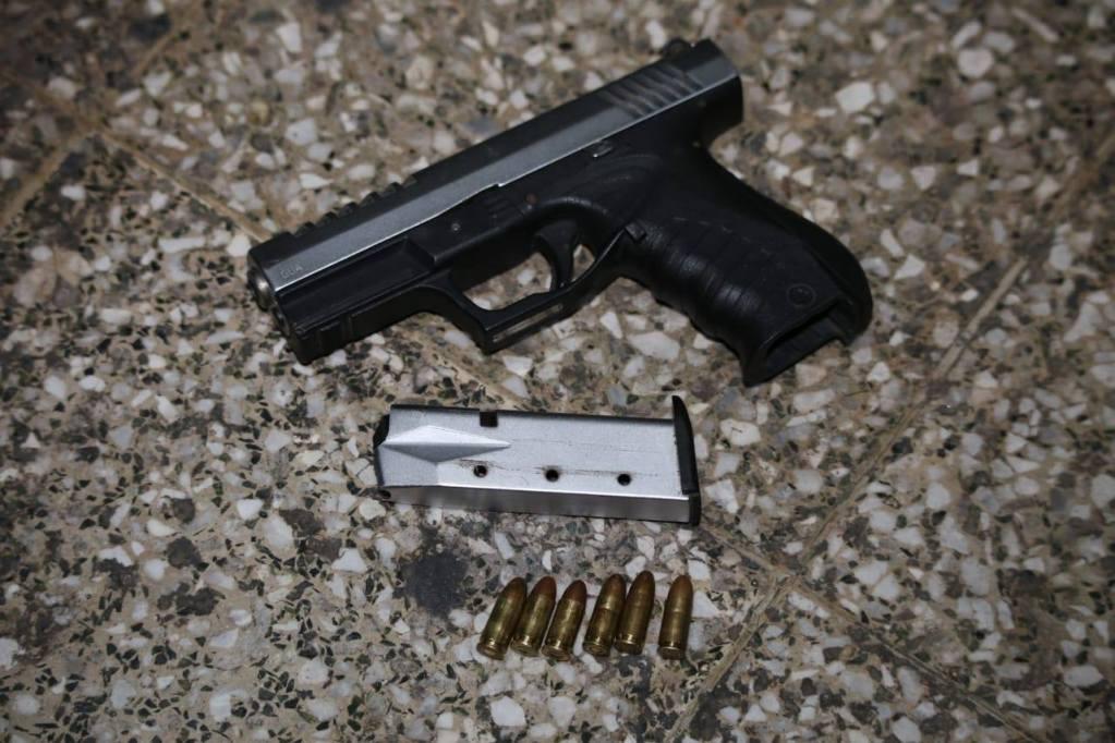 Arma utilizada en asalto en Amatitlán, los capturados fueron grabados por cámaras de vigilancia