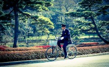 A security guard (or cop) cycling round the Tokyo Imperial Palace gardens. They love their old school Euro-style uniforms in Japan.