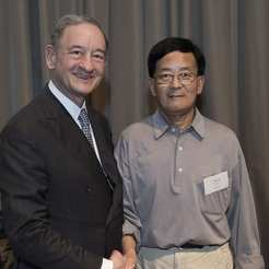 Award recipient Heping Yan, MD, with Chancellor Mark S. Wrighton.