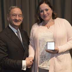 Award recipient Olga Green, PhD, with Chancellor Mark S. Wrighton.