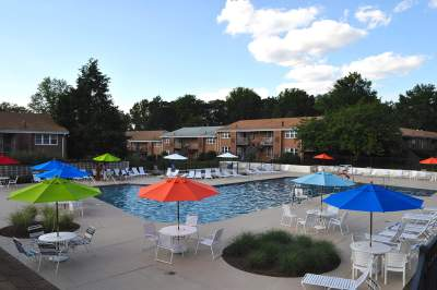 Swimming pool with lounge chairs, tables, and umbrellas in Bryn Mawr, PA