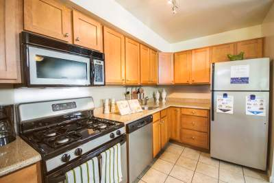 Kitchen with wooden cabinets and stainless steel appliances in Brywn Mawr, PA apartments