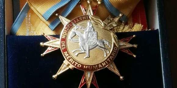 Gran Cruz merit award for humanitarian work