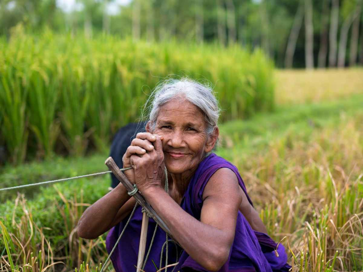 smiling woman at the field