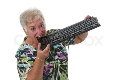 Female senior with keyboard - isolated on white background