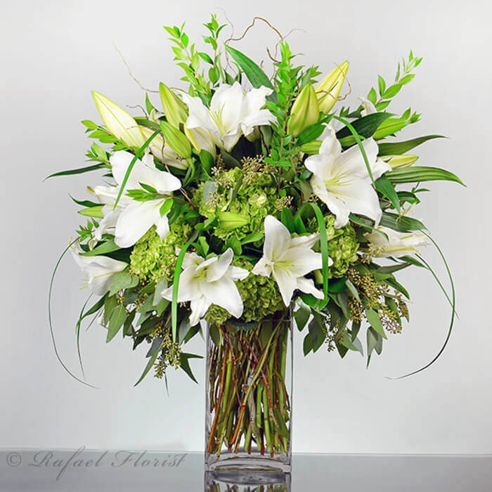 7be48bd4ea47 serene floral arrangement of white Casablanca lilies and green ...