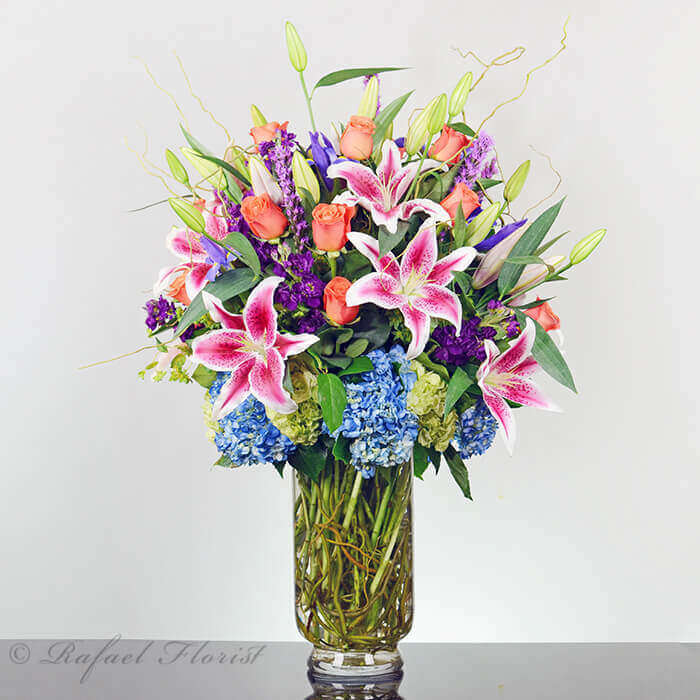 Send This Unforgettable Design Of Lilies Hydrangeas Roses And Purple