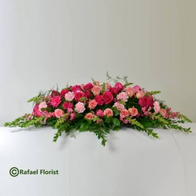 Casket flowers with pink roses and carnations