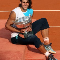 Spanish player Rafael Nadal holds the tr