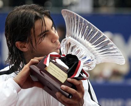 Spain's Rafael Nadal kisses his trophy a