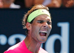Nadal of Spain reacts after defeating Youzhny of Russia in their men's singles match at the Australian Open 2015 tennis tournament in Melbourne