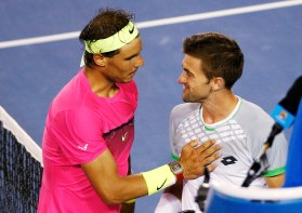Nadal of Spain consoles Smyczek of the U.S. after their men's singles second round match at the Australian Open 2015 tennis tournament in Melbourne