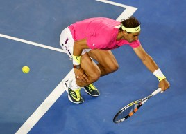 Rafael Nadal of Spain stretches to hit a return against Dudi Sela of Israel during their men's singles third round match at the Australian Open 2015 tennis tournament in Melbourne