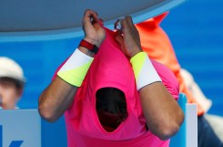Nadal of Spain takes off his shirt during a break in play against Anderson of South Africa in their men's singles match at the Australian Open 2015 tennis tournament in Melbourne