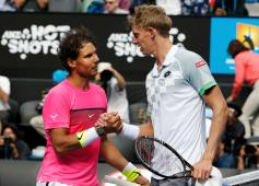 Nadal of Spain shakes hands with Anderson of South Africa after winning their men's singles match at the Australian Open 2015 tennis tournament in Melbourne