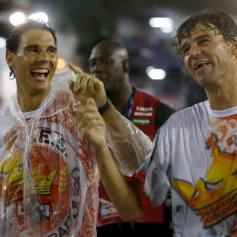 Former tennis player Gustavo Kuerten of Brazil and tennis player Rafael Nadal of Spain attend the annual carnival parade in Rio de Janeiro's Sambadromeennis player Rafael Nadal of Spain attends the annual carnival parade in Rio de Janeiro's Sambadrome,