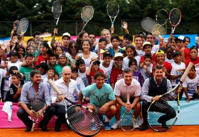 Spain's Rafael Nadal poses for a picture with children during a tennis clinic in Buenos Aires