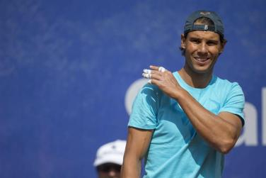 Rafael Nadal smiles during practice session at the Barcelona Open 2015