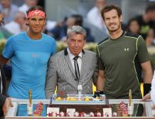 Rafael Nadal of Spain, left, and Andy Murray of Britain, right, pose for photographers as they celebrate the birthday of former Spanish tennis ace Manolo Santana, center, prior to their men's singles final match at the Madrid Open Tennis tournament in Madrid, Spain, Sunday May 9, 2015. (AP Photo/Paul White)