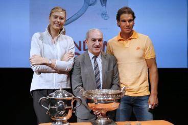 Russian tennis player Maria Sharapova, President of the French Tennis Federation Jean Gachassin, and Spanish player Rafael Nadal, seen at the draw for the first round of the French Open in Paris on May 22, 2015