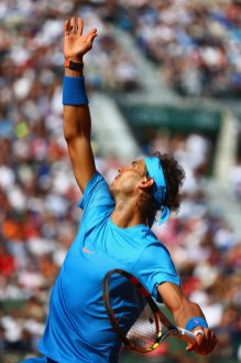 PARIS, FRANCE - MAY 30: Rafael Nadal of Spain serves in his Men's Singles match against Andrey Kuznetsov of Russia on day seven of the 2015 French Open at Roland Garros on May 30, 2015 in Paris, France. (Photo by Clive Mason/Getty Images)