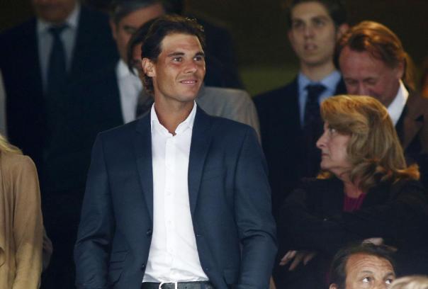 Tennis player Rafael Nadal watches the Spanish La Liga soccer match between Real Madrid and Valencia at the Santiago Bernabeu stadium in Madrid, Spain, Saturday May 9, 2015. (AP Photo/Oscar del Pozo)