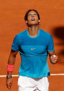 Rafael Nadal of Spain celebrates after winning his semifinal of the Madrid Open Tennis tournament in Madrid, Spain, Saturday, May 9, 2015. Nadal defeated Tomas Berdych of the Czech Republic 7/6, 6/1. (AP Photo/Daniel Ochoa de Olza)