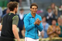 MADRID, SPAIN - MAY 10: Andy Murray of Great Britain is applauded by Rafael Nadal of Spain after his straight sets victory in the mens final during day nine of the Mutua Madrid Open tennis tournament at the Caja Magica on May 10, 2015 in Madrid, Spain. (Photo by Clive Brunskill/Getty Images)