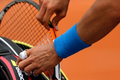 PARIS, FRANCE - MAY 26: A detailed view as Rafael Nadal of Spain changes racquet in his Men's Singles match against Quentin Halys of France on day three of the 2015 French Open at Roland Garros on May 26, 2015 in Paris, France. (Photo by Clive Brunskill/Getty Images)