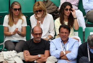 Rafael Nadal of Spain's mother Ana Maria Parera and girlfriend Xisca Perello sit behind his father Sebastian Nadal as they watch him during his men's singles match against Quentin Halys of France on day three of the 2015 French Open at Roland Garros on May 26, 2015 in Paris, France. (May 25, 2015 - Source: Clive Brunskill/Getty Images Europe)
