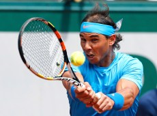 Rafael Nadal of Spain plays a shot to Quentin Halys of France during their men's singles match at the French Open tennis tournament at the Roland Garros stadium in Paris, France, May 26, 2015. REUTERS/Pascal Rossignol