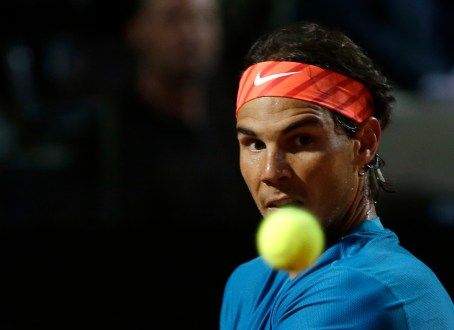 Spain's Rafael Nadal returns the ball to Switzerland's Stan Wawrinka during a quarter final match at the Italian Open tennis tournament, in Rome, Friday, May 15, 2015. (AP Photo/Alessandra Tarantino)