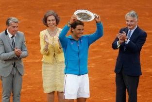 Rafael Nadal of Spain lifts his second place trophy at the end of the final of the Madrid Open Tennis tournament in Madrid, Spain, Sunday, May 10, 2015. Andy Murray of Great Britain defeated Nadal 6/3, 6/2. (AP Photo/Daniel Ochoa de Olza)