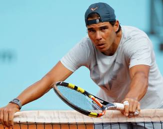 Rafael Nadal takes rest during practice session in Madrid