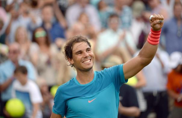 Spain's Rafael Nadal  raises his fist after he won the semifinal tennis match against Gael Monfils from France, at the ATP Mercedes Cup tennis tournament in Stuttgart, Germany, Saturday June 13, 2015. ( Marijan Murat/dpa, via AP)