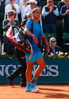 PARIS, FRANCE - JUNE 03: Rafael Nadal of Spain waves to the fans after defeat in his Men's quarter final match against Novak Djokovic of Serbia on day eleven of the 2015 French Open at Roland Garros on June 3, 2015 in Paris, France. (Photo by Julian Finney/Getty Images)