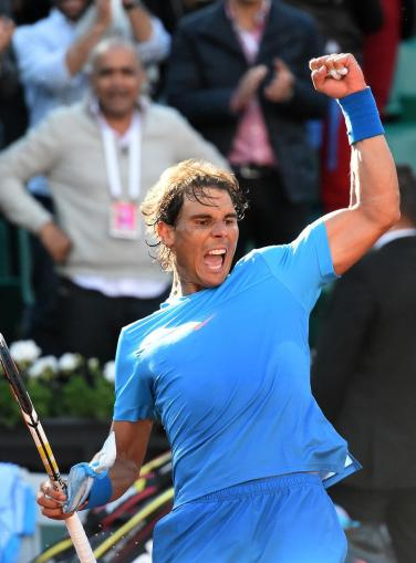 Spain's Rafael Nadal celebrates his victory over US Jack Sock at the end of their men's fourth round of the Roland Garros 2015 French Tennis Open in Paris on June 1, 2015. AFP PHOTO / PASCAL GUYOT