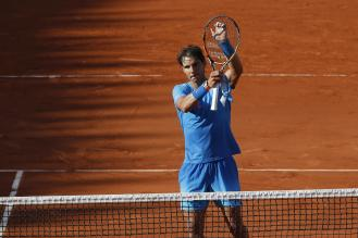 Spain's Rafael Nadal celebrates winning the fourth round match of the French Open tennis tournament against Jack Sock of the U.S. in four sets 6-3, 6-1, 5-7, 6-2, at the Roland Garros stadium, in Paris, France, Monday, June 1, 2015. (AP Photo/Michel Euler)