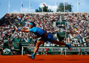 PARIS, FRANCE - JUNE 01: Rafael Nadal of Spain returns a shot in his Men's Singles match against Jack Sock of the United States on day nine of the 2015 French Open at Roland Garros on June 1, 2015 in Paris, France. (Photo by Julian Finney/Getty Images)