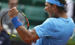 Spain's Rafael Nadal clenches his fist after scoring a point in his fourth round match of the French Open tennis tournament against Jack Sock of the U.S. at the Roland Garros stadium, in Paris, France, Monday, June 1, 2015. Nadal won in four sets, 6-3, 6-1, 5-7, 6-2. (AP Photo/Thibault Camus)