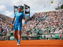 Rafael Nadal of Spain prepares to serve to Jack Sock of the U.S. during their men's singles match during the French Open tennis tournament at the Roland Garros stadium in Paris, France, June 1, 2015. REUTERS/Vincent Kessler